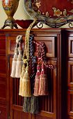 foto of tassels  - Luxury tassels for beautiful curtain display on wooden cabinet - JPG