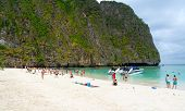 PHI PHI ISLANDS, THAILAND - APRIL 4: Unidentified people visit the bay with white sand beach on Apri