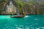 PHI PHI ISLANDS, THAILAND - APRIL 4: Unidentified people visit and swim in lagoon with turquoise wat