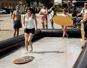 College Girl Surf Rides In The City Center