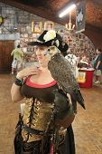 MUSKOGEE, OK - MAY 24: Handler shows a bird of prey at the Oklahoma 19th annual Renaissance Festival
