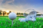image of golf bag  - Golf game concept close up of Golf balls in grass. ** Note: Shallow depth of field - JPG