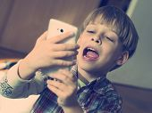 boy taking selfie with smartphone