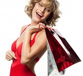 portrait of attractive  caucasian smiling woman blond isolated on white studio shot  toothy smile  hair red dress shopping bags sale