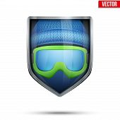 Bright shield in the winter cap and ski goggles inside. Vector.