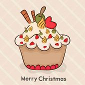 Merry Christmas celebration concept with delicious cupcake on stylish pink background.