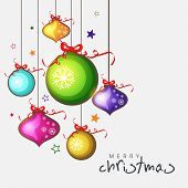 Merry Christmas celebrations greeting card decorated with colorful shiny X-mas balls and stars on grey background.