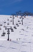 Skiers And Two Chairlifts In Solden, Austria