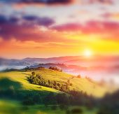 Majestic sunset in the mountains landscape. Dramatic sky. Carpathian, Ukraine, Europe. Beauty world. Retro style filter. Instagram toning effect. Tilt Shift blur effect.