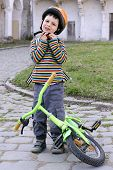 Child With Helmet And Bike.