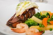 picture of lobster tail  - A seafood dinner of lobster tail shrimp and vegetables - JPG
