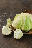 fresh organic white cauliflower on old iron table