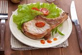 picture of pork cutlet  - Fried pork cutlet with fresh green lettuce tomato and sauce on the white plate - JPG