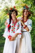 Two beautiful models in national costumes
