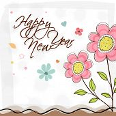 Beautiful greeting card decorated with stylish text and flowers for Happy New Year celebrations.