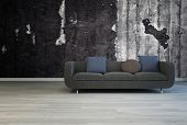 3D Rendering of Black couch against grunge dark concrete wall