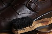 Brown leather classic Brogue shoes with polishing cream and wooden brush