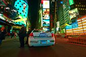 NEW YORK CITY - APRIL 02: Police car at Times Square at night on April 02, 2014.