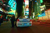 NEW YORK CITY - APRIL 02: Police car at Times Square at night on April 02, 2014.