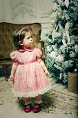 little girl near cristmass tree, holiday picture