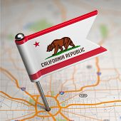 California Small Flag on a Map Background.