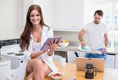 Young couple spending the morning together at home in the kitchen
