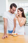 Young couple having a healthy breakfast at home in the kitchen