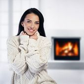 Woman Relaxing By The Fireplace
