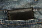 Back leather wallet in jeans back pocket