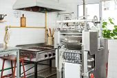 Ravioli pasta machine by stove in commercial kitchen