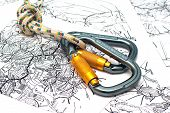 Two Alpinism Carabiners On A Map Background