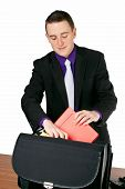 Businessman Packing His Briefcase