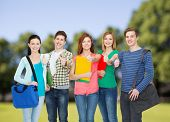 education and people concept - group of smiling students standing