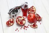 pomegranate fruits, pomegranate juice and juice press
