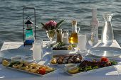 foto of ouzo  - seafoods on the dinner table at the beach - JPG