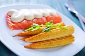 foto of mange-toute  - fried salmon and corn on the white plate - JPG