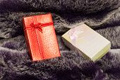 Gift Box On Wool Texture.