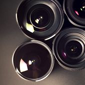 Set Of Dslr Lenses, Different Types And Reflections. Top View.