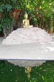 Buddha seated on a mound.