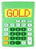 Calculator With Gold On Display Isolated