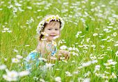 Toddler Girl On The Daisy Meadow