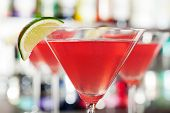 pic of cosmopolitan  - Four Cosmopolitan cocktails shot on a bar counter in a night club - JPG