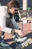 pic of skate  - Woman preparing to skate in the park - JPG