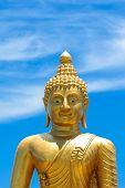 stock photo of budha  - Detail of the Phuket Golden Big Budha in Thailand - JPG
