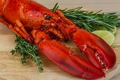 pic of lobster tail  - Red boiled lobster with thyme and rosemary - JPG