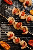 stock photo of crust  - Grilled Parmesan crust shrimp with chery tomatoes on the grill with grilled mini bell peppers - JPG
