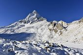 stock photo of mahadev  - dramatic granite Mount Shivling 6543 meters high - JPG