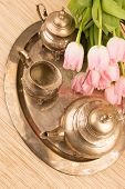 picture of pompous  - antik table set with pink tulips on a table - JPG