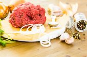 stock photo of ground-beef  - Ground beef on the table with other ingredients for recipe. ** Note: Shallow depth of field - JPG