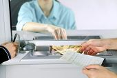 foto of cashiers  - Teller window with working cashier  - JPG
